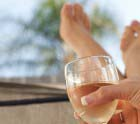 Womans Hands Holding Glass Of White Wine