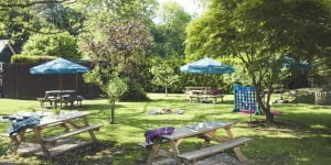 Garden with picnic benches at The Stag on the River