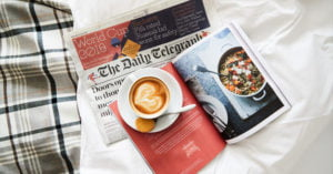 Coffee and morning papers in bed